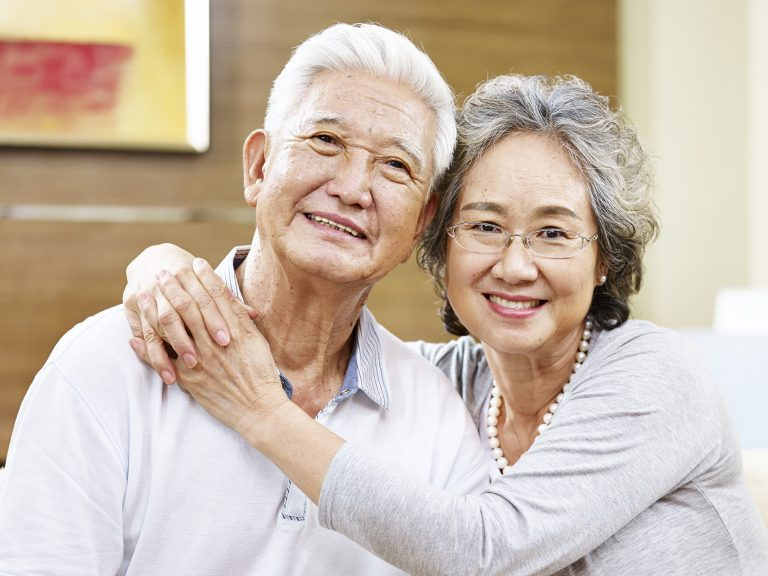 Portrait Of A Loving Senior Asian Couple
