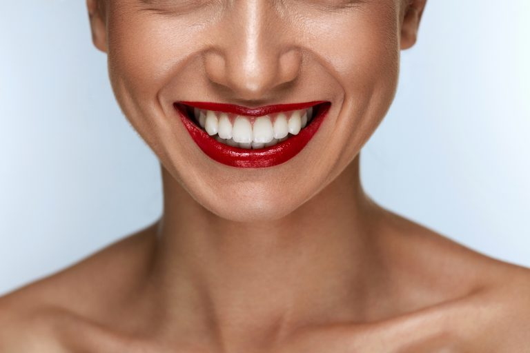 Beautiful Smile With Healthy White Teeth And Red Lips